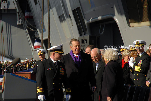 Norfolk, VA - January 10, 2009 -- Former United States President George H.W. Bush is escorted aboard the aircraft carrier USS George H.W. Bush during the ship?s commissioning ceremony. Bush delivered the keynote address at the commissioning. The Navy's newest, and final, Nimitz-class aircraft carrier is named after the World War II naval aviator and 41st president of the United States. .Credit: Demetrius Patton - U.S. Navy via CNP