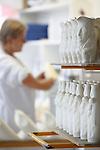 Proceso de creacion de ceramica en la fabrica de Sargadelos en Cervo, Lugo. Eliminacion, con una esponja, de las marcas que deja el molde en la superficie de la pieza.