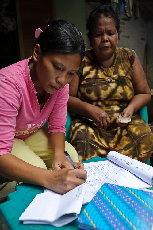 Women running a microfinance saving and credit scheme, Tallo, Makassar, Sulawesi, Indonesia.