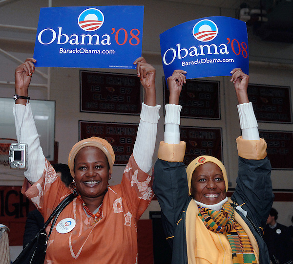 Claremont, New Hampshire: November 12, 2007.Louissa Kabae of Tanzania, left, and Nkoya Grace Thabane of Losotho, cheer for presidential candidate Barack Obama during a campaign town hall meeting held inside a  gymnasium at Stevens High School. These African supporters of Obama were visiting the United States under the auspices of a State Department program teaching them about grassroots campaigning.  ©Christopher Fitzgerald / CandidatePhotos.com