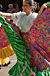A girl dressed in traditional Colombian clothes, walks in the Hispanic Parade in New York City