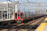A southbound Metro-North New Haven line commuter train arrives at the station in Stamford, Connecticut.