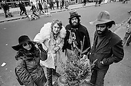 December 1969 --- French actor Yves Renier (2nd from the L) poses next to a small Christmas tree with a woman and two men during a visit to New York City. --- Image by © JP Laffont