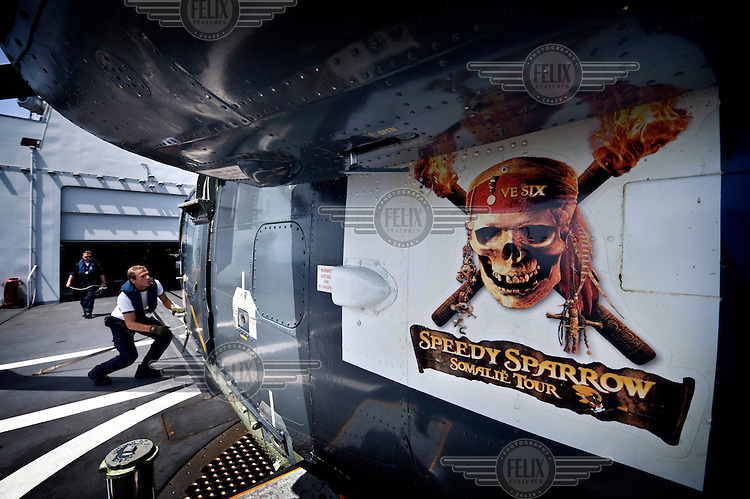 A sticker showing a laughing skull and the words 'Somalia Tour' is pasted to the side of a Lynx helicopter charged with patroling the seas around the Somali coast. Many WFP (World Food Programme) aid ships have been hijacked by pirates in these waters, and the Dutch Navy monitor the vessels to try and prevent further attacks.