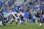 Ole Miss quarterback Randall Mackey (1) is tackled by Kentucky's Winston Guy (21) and Kentucky's Collins Ukwu (96) at Commonwealth Stadium in Lexington, Ky. on Saturday, November 5, 2011. Kentucky won 30-13...