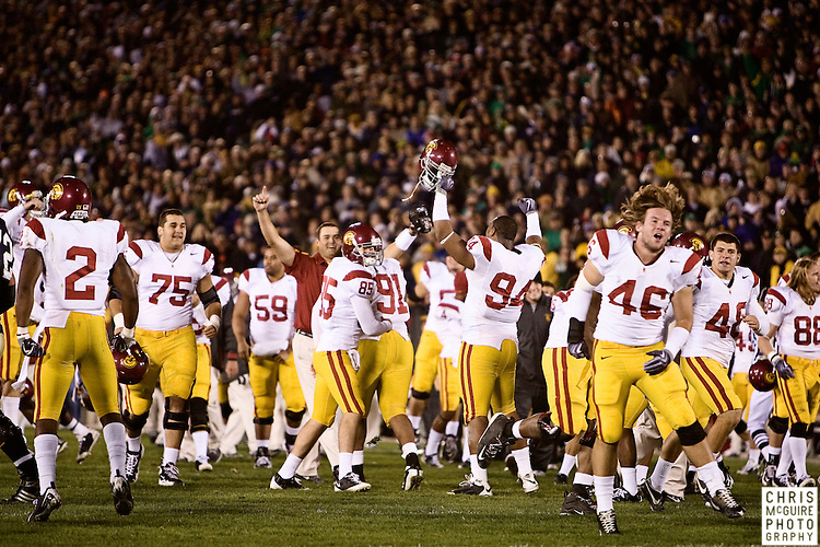 10/17/09 - South Bend, IN:  USC celebrates following a fourth quarter goal line stand against Notre Dame at Notre Dame Stadium on Saturday.  USC won the game 34-27 to extend its win streak over Notre Dame to 8 games.  Photo by Christopher McGuire.