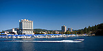 Idaho,North,Coeur d'Alene. A speed boat leaves the boardwalk marina surrounding the world class Coeur d'Alene Resort  in the tourist town of Coeur d'Alene.