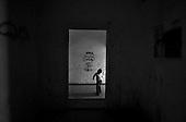 Wroclaw 13.08.2006 Poland<br /> The worst and the most dangerous district in Wroclaw ( Poland ), called by people &quot;The Bermuda Triangle&quot;. There are walls bearing an inscription &quot;Who will enter here, will not exit alive&quot; Many families there are pathological and live in extreme poverty. Children have no place for any games so they loaf around on this wasted district and disseminate a juvenile delinquency. Many of them become sexually active though they are only 10-12 years old<br /> (Photo by Adam Lach / Napo Images)<br /> <br /> Najbardziej nabezpieczna dzielnica we Wroclawiu zwana przez ludzi Trojkatem Bermudzkim. Sa tam sciany opatrzone napisem &quot; Kto tu wejdzie, nigdy nie wyjdzie stad zywy&quot; Mieszka tam wiele rodzin patologicznych i zyja w wielkiej nedzy. Dzieci wlocza sie po ulicach nie majac miejsc na zabawe i szerza przestepczosc wsrod nieletnich. Wiele z dzieci uprawia seks choc maja zaledwie 10-12 lat<br /> (Fot Adam Lach / Napo Images)