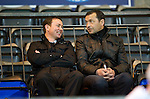 St Johnstone v Brechin....22.03.11  Scottish Cup Quarter Final replay.Hibs manager Colin Calderwood and assistant Derek Adams watch the game.Picture by Graeme Hart..Copyright Perthshire Picture Agency.Tel: 01738 623350  Mobile: 07990 594431