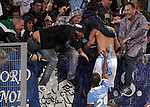 Calcio, Serie A: Lazio vs Palermo. Roma, stadio Olimpico, 2 settembre 2012..Lazio midfielder Antonio Candreva celebrates with fans and teammate Abdoulay Konko, bottom, after scoring during the Italian Serie A football match between Lazio and Palermo at Rome's Olympic stadium, 2 September 2012..UPDATE IMAGES PRESS/Riccardo De Luca