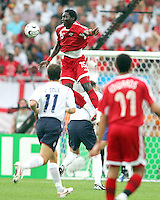 Kenwyne Jones of Trinidad gets very high over John Terry of England. England defeated Trinidad & Tobago 2-0 in their FIFA World Cup group B match at Franken-Stadion, Nuremberg, Germany, June 15 2006.