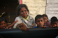 Poverty in Sri Lanka, Tamil women and children along the road asking for money.