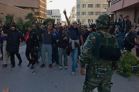 Tunis, January 14, 2011.Everywhere it is present, the Army tries to peacefully separate the population from the aggressive police and militia.