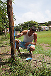 2012 August 06: Painting the posts of the soccer field at the center of town in Playa Sámara, Costa Rica.  The field will eventually be used for lacrosse.