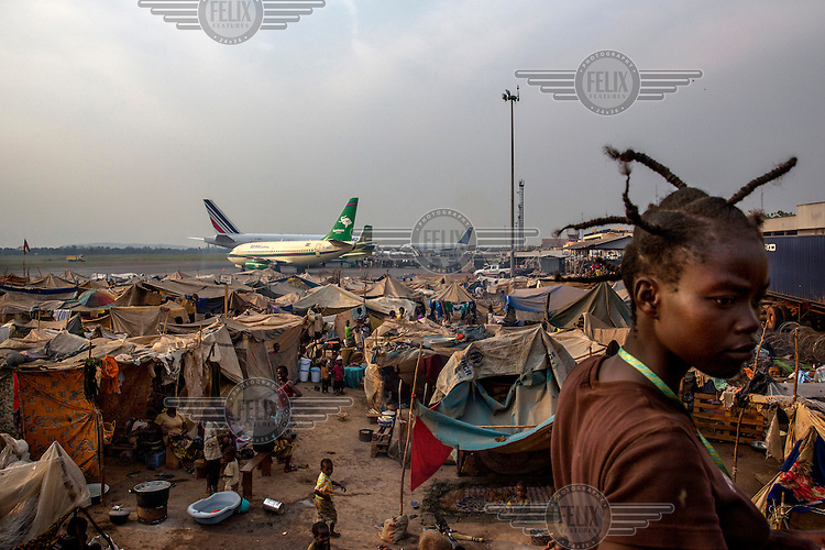 A camp at M'Poko's International Airport crowded with people who sought refuge from Seleka fighters in 2013. They have stayed there since as the situation in the country has deteriorated. In 2013 a rebellion by a predominantly Muslim rebel group Seleka, led by Michel Djotodia, toppled the government of President Francios Bozize. Djotodia declared that Seleka would be disbanded but as law and order collapsed the ex-Seleka fighters roamed the country committing atrocities against the civilian population. In response a vigillante group, calling themselves Anti-Balaka (Anti-Machete), sought to defend their lives and property but they then began to take reprisals against the Muslim population and the conflict became increasingly sectarian. French and Chadian peacekeeping forces have struggled to contain the situation and the smaller Muslim population began to flee the country.