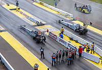 Aug 21, 2016; Brainerd, MN, USA; Crew members for NHRA top fuel driver Clay Millican stand behind his dragster as he prepares to race Antron Brown during the Lucas Oil Nationals at Brainerd International Raceway. Mandatory Credit: Mark J. Rebilas-USA TODAY Sports