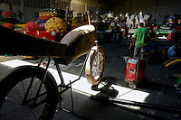 An unfinished paper-made statue of a bicycle parked in the Carnival workshop, Barranquilla, Colombia, 23 February 2006. The Carnival of Barranquilla is a unique festivity which takes place every year during February or March on the Caribbean coast of Colombia. The allegorical floats and masks are created by artists with their teams. These crews are highly specialized to design and create large floats because they keep this profession in the family for decades.