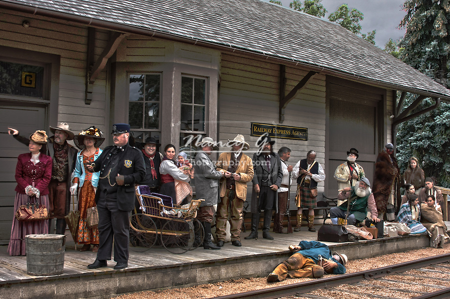Group of old fashioned towns people waiting for the train at the train station platform