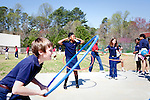 Bryseton Bumgardner (left to right), 10, hula hoops with classmates Serina Yenglee, 10, and Hannah Wallace, 9, outside at Kennesaw Charter School in Kennesaw, Georgia, April 1, 2010. The 440 student school, which used to be managed by Imagine Schools, is now self-managed.