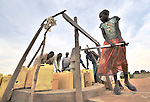 Women and girls fetch water at a well provided by the United Methodist Committee on Relief (UMCOR) in Yei, Southern Sudan...