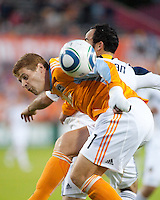 Andrew Hainault of the Houston Dynamo and Landon Donovan of the Los Angeles Galaxy get tangled up as they fight for the header during the regular season game between the Los Angeles Galaxy and the Houston Dynamo at Robertson Stadium in Houston, TX on April 10, 2010. Los Angeles 2, Houston 0.