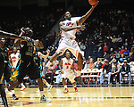 "Ole Miss' Murphy Holloway (31) is fouled by Coastal Carolina's Badou Diagne (23) at the C.M. ""Tad"" Smith Coliseum in Oxford, Miss. on Tuesday, November 13, 2012. (AP Photo/Oxford Eagle, Bruce Newman)"