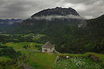 View of stone building, surrounding hamlet and countryside from Ehrenberg schloss. Reutte district, Tyrol/Tirol. Austria.