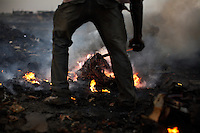 Burning cables from computers and other electronic equipment to retrieve copper, at Agbogbloshie dump, in Accra, Ghana. Burning creates some of the most carcinogenic and toxic substances known, including polycyclic aromatic hydrocarbons, dioxins and furans. At theses burning sites concentrations of toxic metals have been found at over one hundred times the normal level.