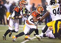 Giovani Bernard #25 of the Cincinnati Bengals carries the ball past Bud Dupree #48 of the Pittsburgh Steelers during the Wild Card playoff game at Paul Brown Stadium on January 9, 2016 in Cincinnati, Ohio. (Photo by Jared Wickerham/DKPittsburghSports)