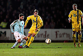 15.01.2013. Torquay, England. Exeter's John O'Flynn beats Billy Bodin to the ball during the League Two game between Torquay United and Exeter City from Plainmoor.