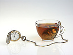A pocket watch and a cup of tea