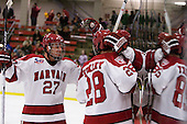 Michael Biega (Harvard - 27), Chris Huxley (Harvard - 28), Danny Biega (Harvard - 9) - The Harvard University Crimson defeated the visiting Colgate University Raiders 6-2 (2 EN) on Friday, January 28, 2011, at Bright Hockey Center in Cambridge, Massachusetts.
