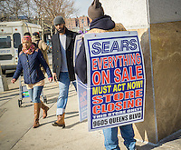 Sandwich board worker advertises at the soon to be closing Sears store in Rego Park in the New York borough of the Queens on Saturday, February 18, 2017. Sears Holdings has deemed the store unprofitable and it will be closing sometime in April. The store is one of the 42 stores they will close in the spring. Sears is also closing 108 Kmart stores. (© Richard B. Levine)