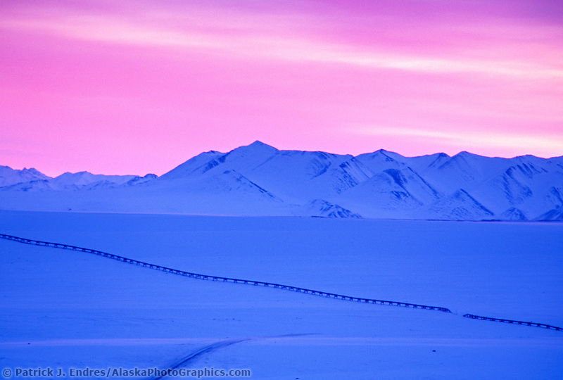 Trans Alaska Oil Pipeline traverses wind blown snow of the Arctic Coastal Plains of Alaska, Philip Smith Mountains of the Brooks range.