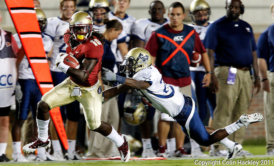 TALLAHASSEE, FL 10-FSU-CSU091011 CH-Florida State's Greg Dent eludes Charleston Southern's Marquiz Hodo during a second half run Saturday at Doak Campbell Stadium in Tallahassee. The Seminoles beat the Buccaneers 62-10..COLIN HACKLEY PHOTO