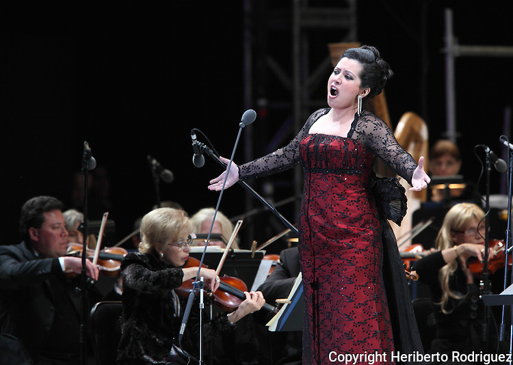 Opera soprano singer Maria Alejandres performs an opera song during the Concert of the Angel in Mexico City, December 19, 2009. Alejandres is a promising young soprano singer who won the International contest Operalia 2008 and launching her career worldwide. Photo by Heriberto Rodriguez