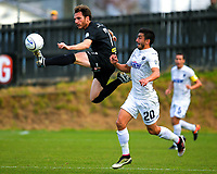 Leonardo Villa (Team Wellington) leaps for the ball under pressure from Emiliano Tade (20) during the Oceania Football Championship final (second leg) football match between Team Wellington and Auckland City FC at David Farrington Park in Wellington, New Zealand on Sunday, 7 May 2017. Photo: Dave Lintott / lintottphoto.co.nz