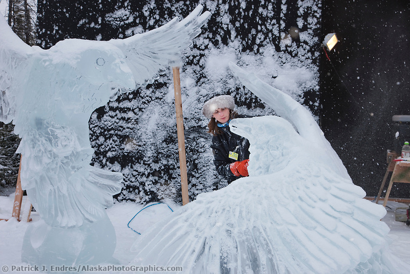 """Alaska artists Heather Brice carves away at a single block realistic category ice sculpture title """"Finders Keepers"""" during the 2009 World Ice Art Championships in Fairbanks, Alaska."""