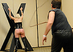 The Long Whip Workshop at the South East Leather Fest. <br /> <br /> If you ever wanted to tie a rope around your partner's scrotum, but were not sure which knot to use, you almost certainly would have enjoyed South East Leather Fest, a weekend-long BDSM convention at the Holiday Inn in downtown Decatur, Georgia. <br /> <br /> Much of the program was dedicated to the technical side of dominance and submission. Workshop topics included foot torture, electric shock, erotic knife play and, whipping technique.<br /> <br /> The instructor of the long-whip class actually left his female volunteer's bottom bloodied (see photo). We might have attended the scrotum-tying workshop had the LeatherFest website not suggested that single males might be recruited as volunteers.