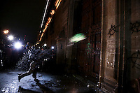 Protesters through a molotov cocktail to set on fire a door at the National Palace in Mexico City.  In support of the 43 student teachers who presumably were killed and incinerated in the state of Guerrero, 11/8/2014 VIEWpress / Miguel Angel Pantaleon