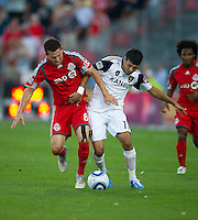 28 August 2010: Real Salt Lake midfielder Javier Morales #11 and Toronto FC defender Dan Gargan #8 in action during a game between Real Salt Lake and Toronto FC at BMO Field in Toronto..The game ended in a 0-0 draw..