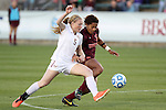 10 November 2013: Florida State's Kacy Scarpa (5) and Virginia Tech's Candace Cephers (18). The Florida State University Seminoles played the Virginia Tech Hokies at WakeMed Stadium in Cary, North Carolina in a 2013 NCAA Division I Women's Soccer match and the championship game of the Atlantic Coast Conference tournament. Florida State won the game 1-0.