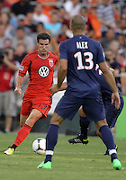 WASHINGTON, DC - July 28, 2012:  Chris Pontius (13) of DC United runs up on Alex (13) of PSG (Paris Saint-Germain) in an international friendly match at RFK Stadium in Washington DC on July 28. The game ended in a 1-1 tie.