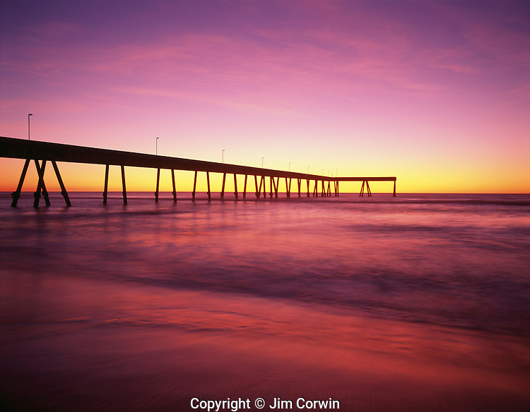 Silhouetted fishing pier at sunset Pacifica California USA
