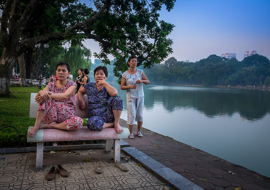 HANOI, VIETNAM - CIRCA SEPTEMBER 2014:  Vietnamese woman early morning in the Hoan Kiem Lake, in Hanoi.