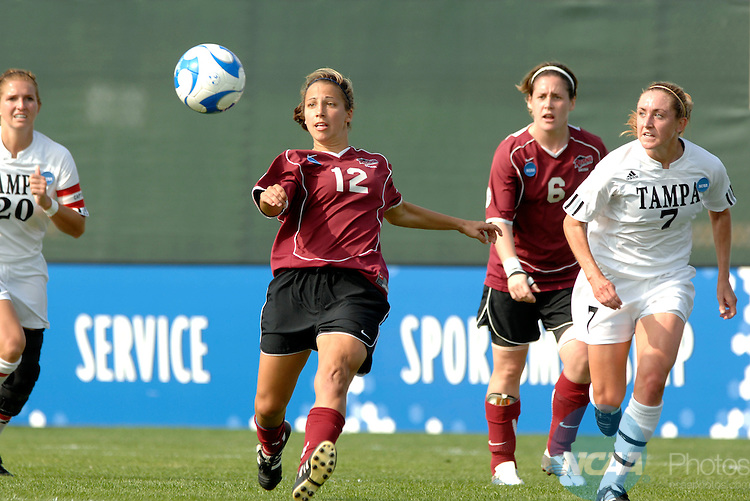 01 DEC 2007: Jenna Giardina (12) of Franklin Pierce kicks the ball down field while Nicole Murphy (7) of  the University of Tampa challenges her during the Division II Women's Soccer Championship held at the City of Orange Beach Sportsplex in Orange Beach, AL. The University of Tampa defeated Franklin Pierce 3-1 for the national title. Stephen Nowland/NCAA Photos