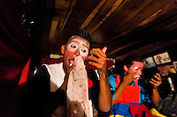 A Salvadorean boy applies makeup before his clown performance at the Circo Brasilia, a family run circus travelling in Central America, 10 May 2011. The Circo Brasilia circus belongs to the old-fashioned traveling circuses with a usual mixture of acrobat, clown and comic acts. Due to the general loss of popularity caused by modern forms of entertainment such as movies, TV shows or internet, these small family enterprises balance on the edge of survival. Circuses were pushed away and now they have to set up their shows in more remote villages. The circus art and culture is slowly dying in Latin America.