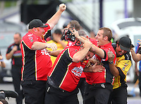 May 1, 2016; Baytown, TX, USA; Crew members for NHRA top fuel driver Doug Kalitta celebrate after winning the Spring Nationals at Royal Purple Raceway. Mandatory Credit: Mark J. Rebilas-USA TODAY Sports