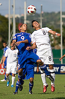 Esteban Rodriguez (9) of the United States and Dairon Perez (9) of Cuba fight a header during the first day of the group stage at the CONCACAF Men's Under 17 Championship at Catherine Hall Stadium in Montego Bay, Jamaica. The United States defeated Cuba, 3-1.