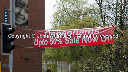 Banner advertising Debenham's 50% off sale, Guildford, Surrey.